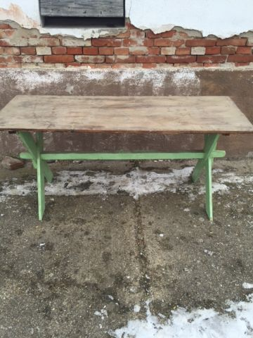 wood table with green criss cross legs