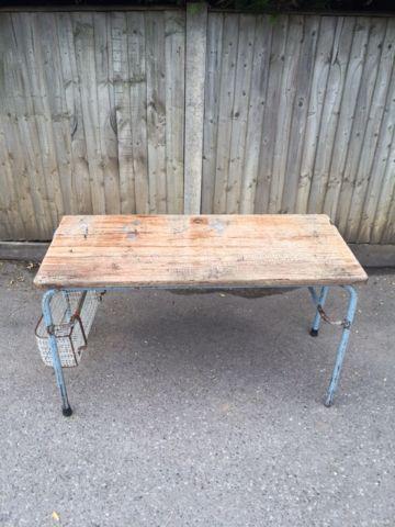 wood base/metal legs with storage basket