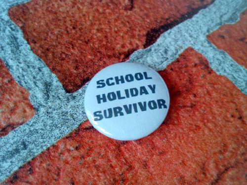 School Holiday Survivor 25mm/1 inch pin badge