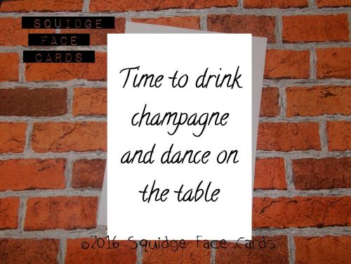 White greeting card with the text *Time ot drink champagne and dance on the