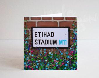 Jo Gough - MCFC Etihad Street Sign with flowers Greeting Card