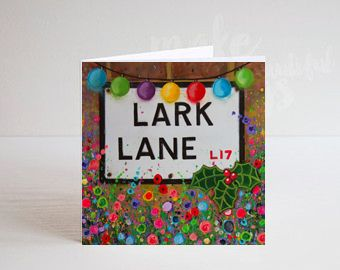 Jo Gough - A Festive Lark Lane St Sign with flowers Christmas Card