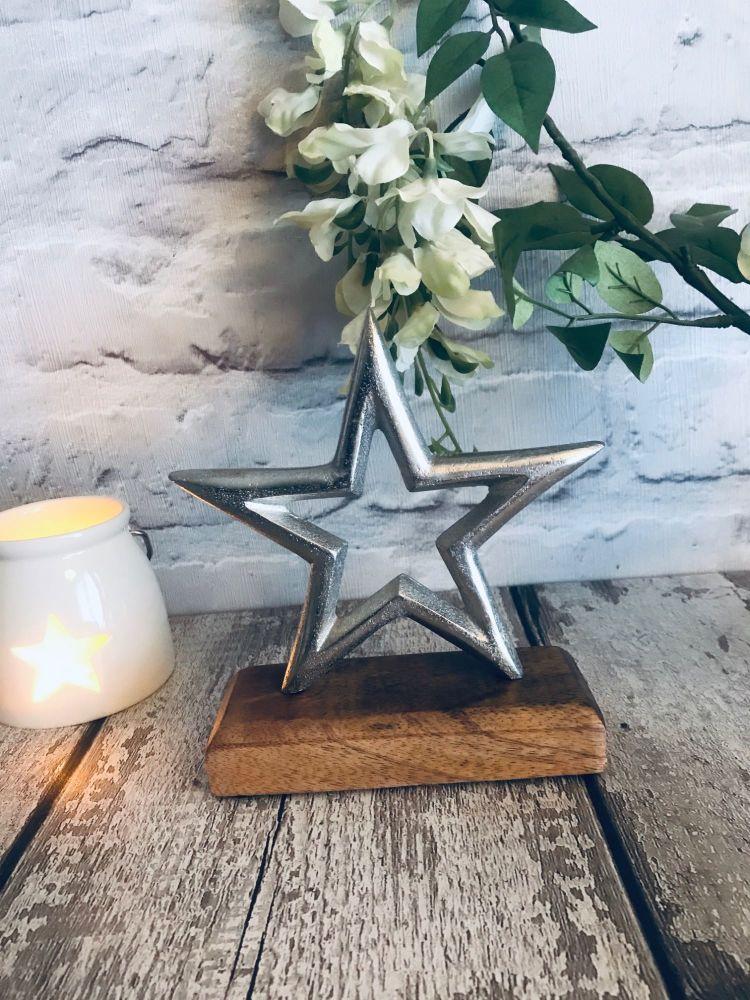 Aluminium Star on wooden block