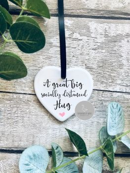 Socially distanced hug ceramic hanging heart