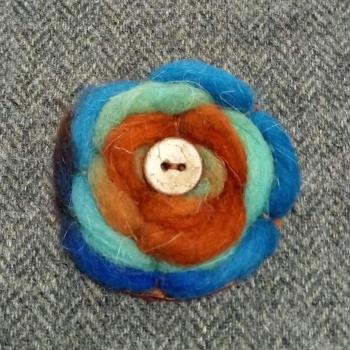 62. wool brooch