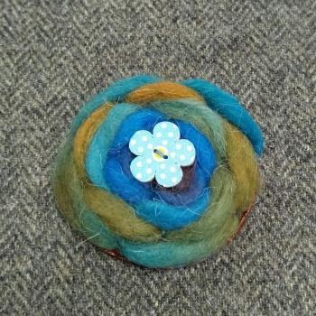 65. wool brooch