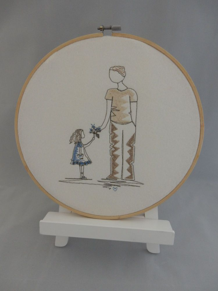 Man and girl in embroidery hoop