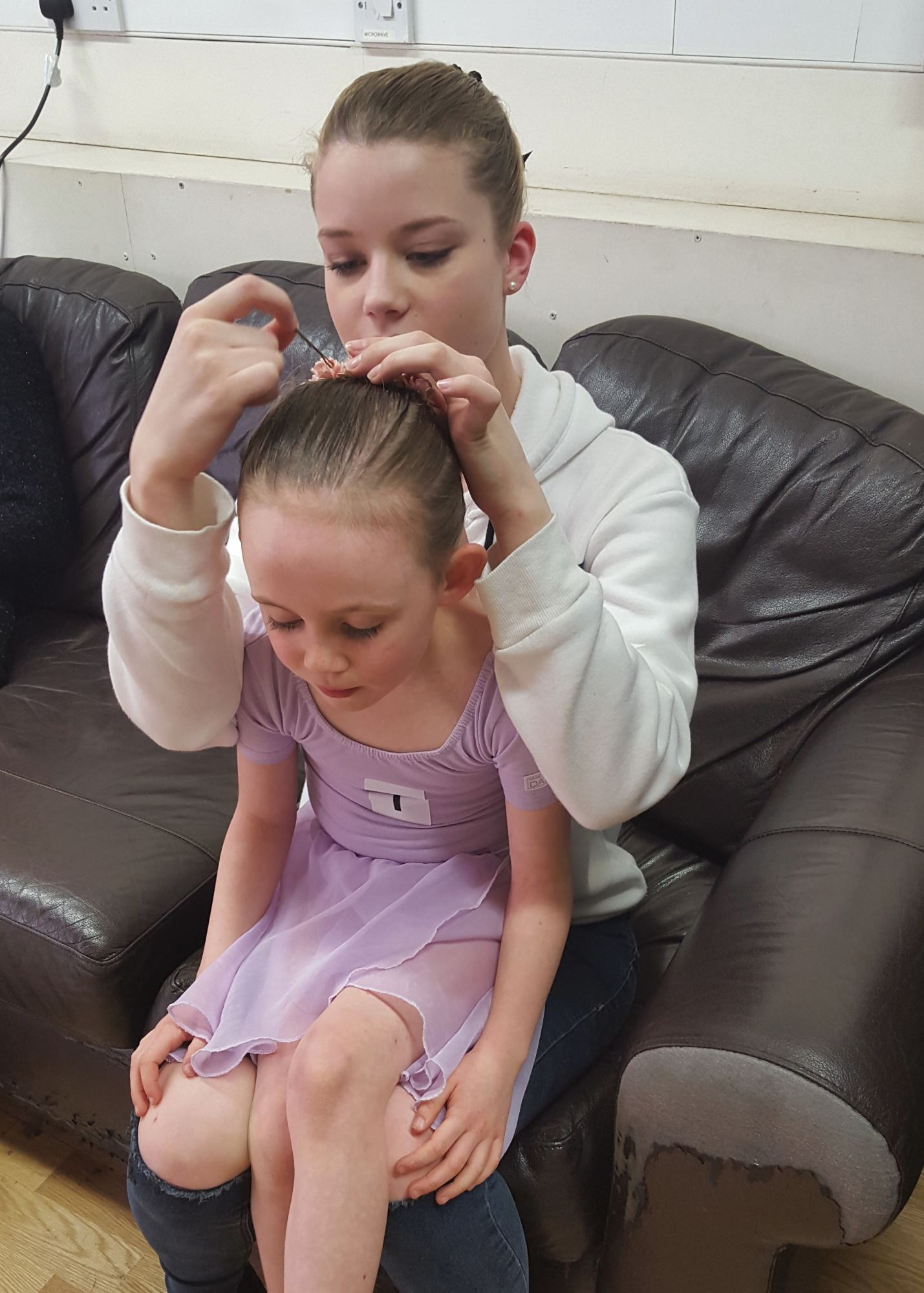Hannah helping Nell with her exam hair at the RAD