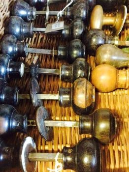 Pairs of reclaimed 1930s wooden door knobs.