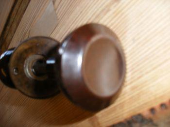 Reclaimed concave style bakelite door handles.