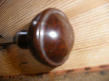 Reclaimed convex style bakelite door handles.