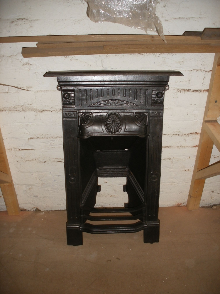 Reclaimed Victorian cast iron fireplace.