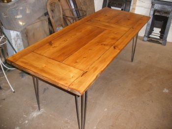Beautiful reclaimed door dining table with hairpin legs