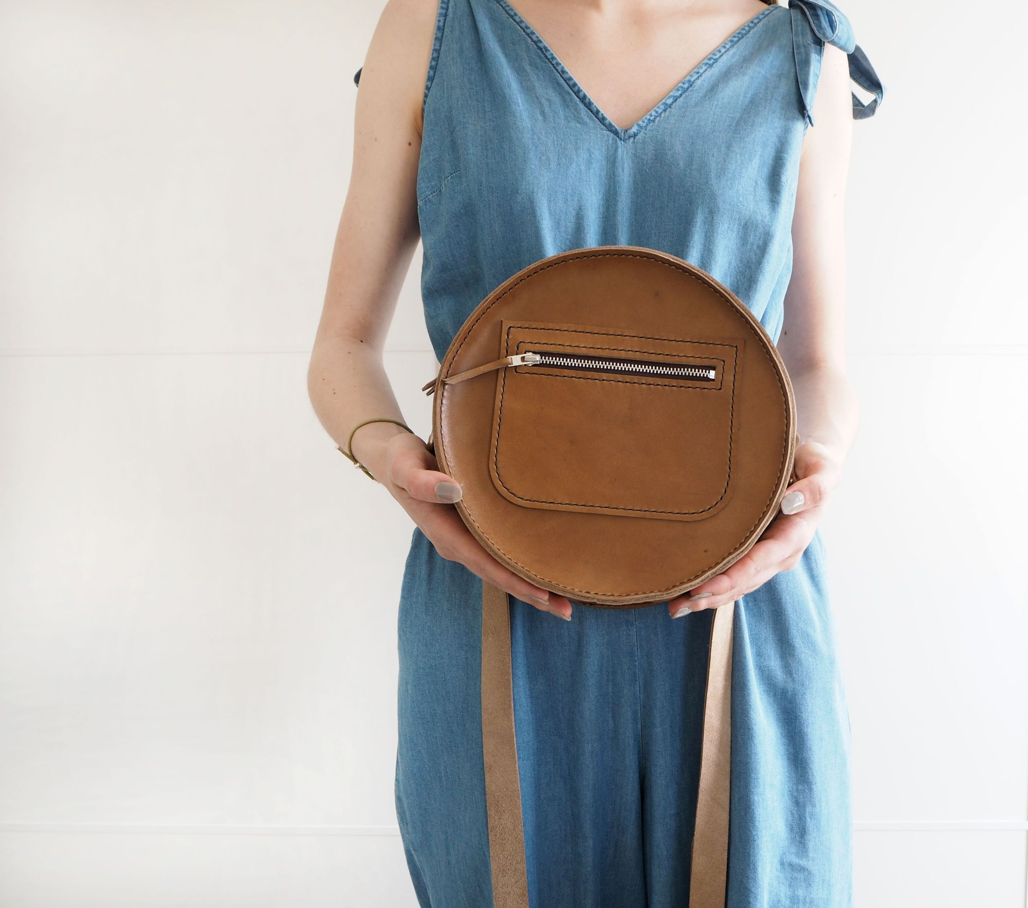 hand stitched round circular leather bag