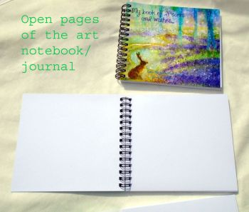 notebook open pages plus book