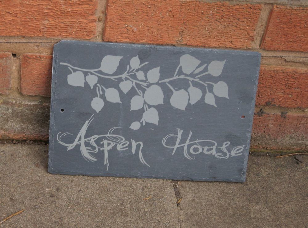 Tree branch house sign