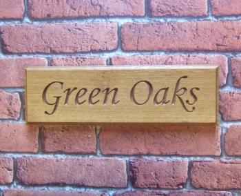 Single Row Carved Oak House Sign