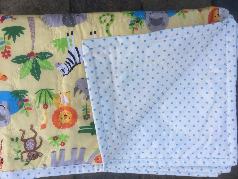 Yellow Jungle fabric pram quilt