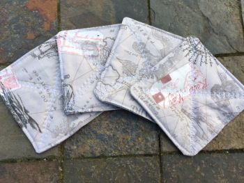 "Quilted ""Atlas/round the world"" themed coasters - set of 4"