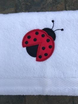 Ladybird appliqué hand towel