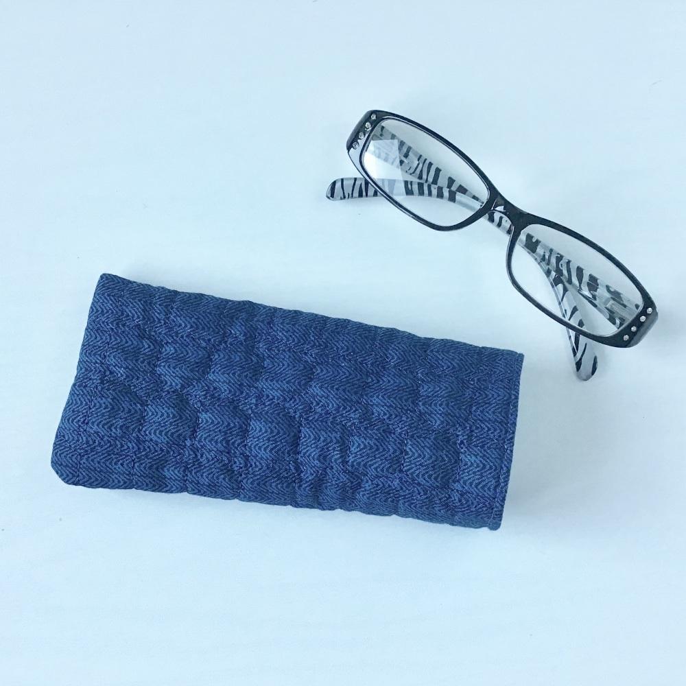 Navy blue herringbone quilted glasses case