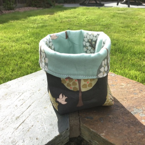 Small tree and bird themed reversible storage bin - 4""