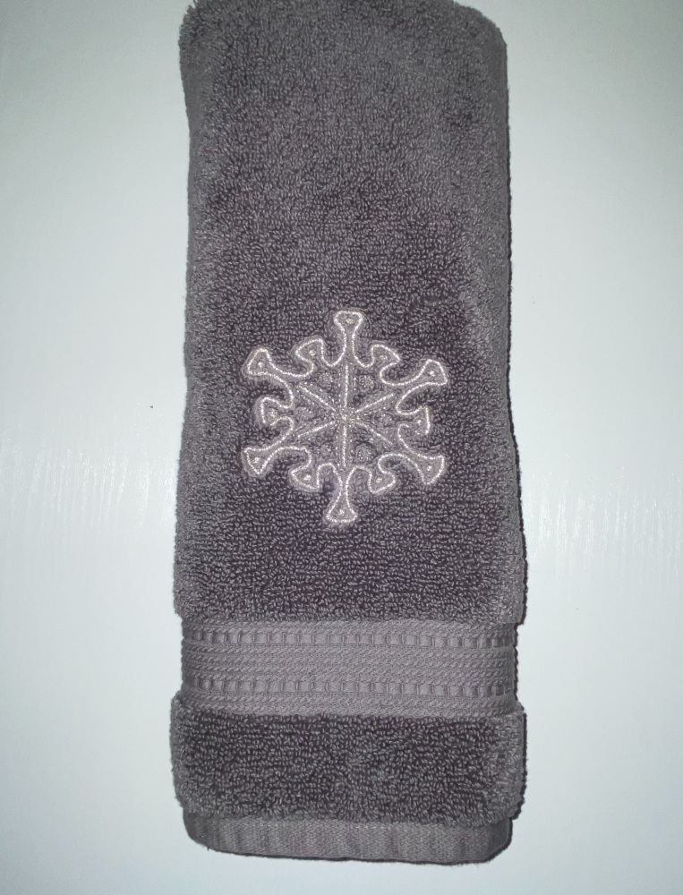 Dark grey Hand towel embroidered with a silver snowflake
