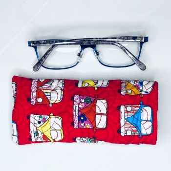 Red quilted reading glasses case with VW style Campervan pattern