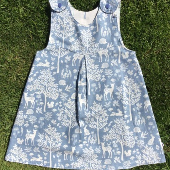 Blue and Cream Forest Animals and Trees Reversible Pinafore Dress  -  in sizes up to 5 years