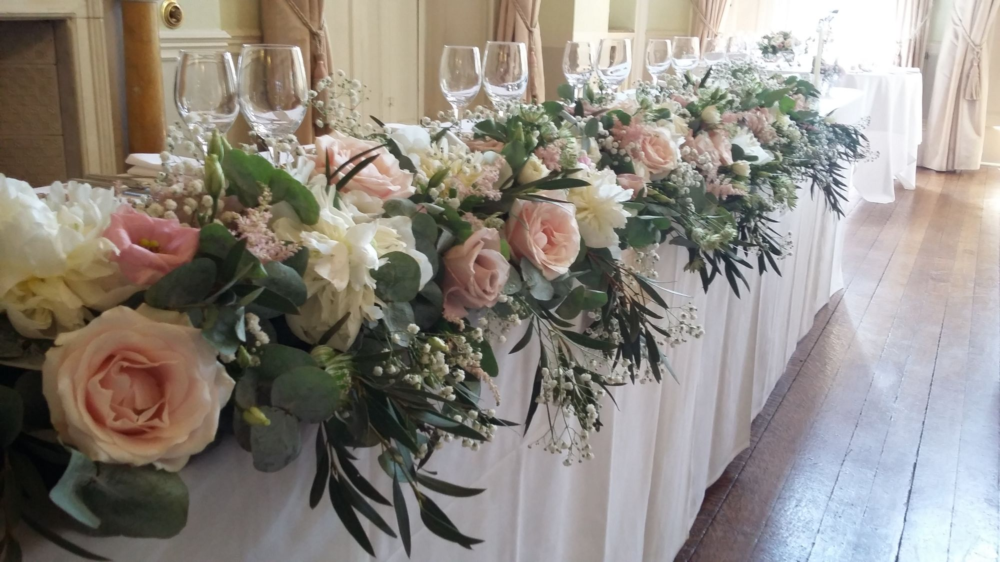 Long top table flowers wedding