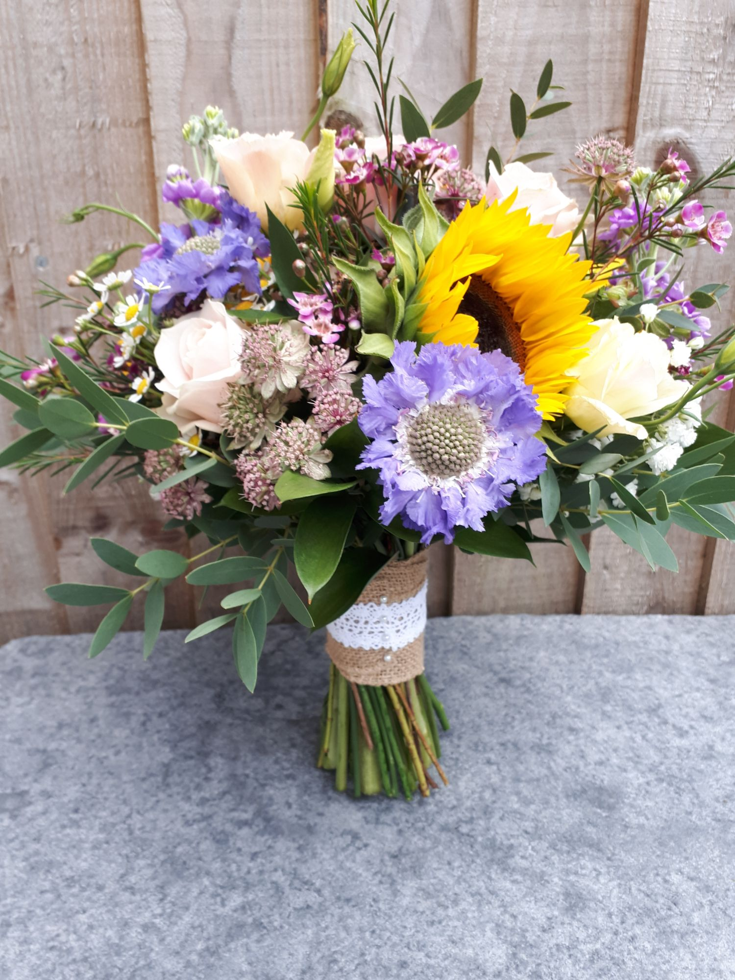 Rustic brides bouquet sunflowers