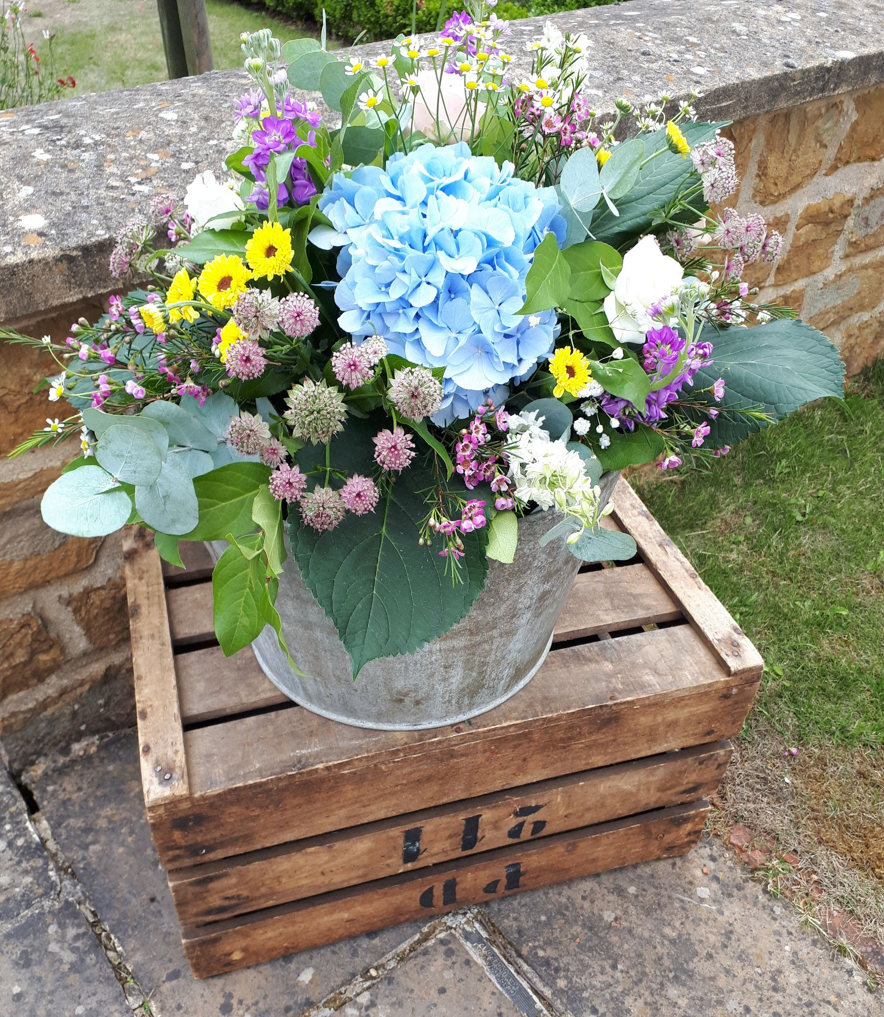 Wedding flowers in tin bucket