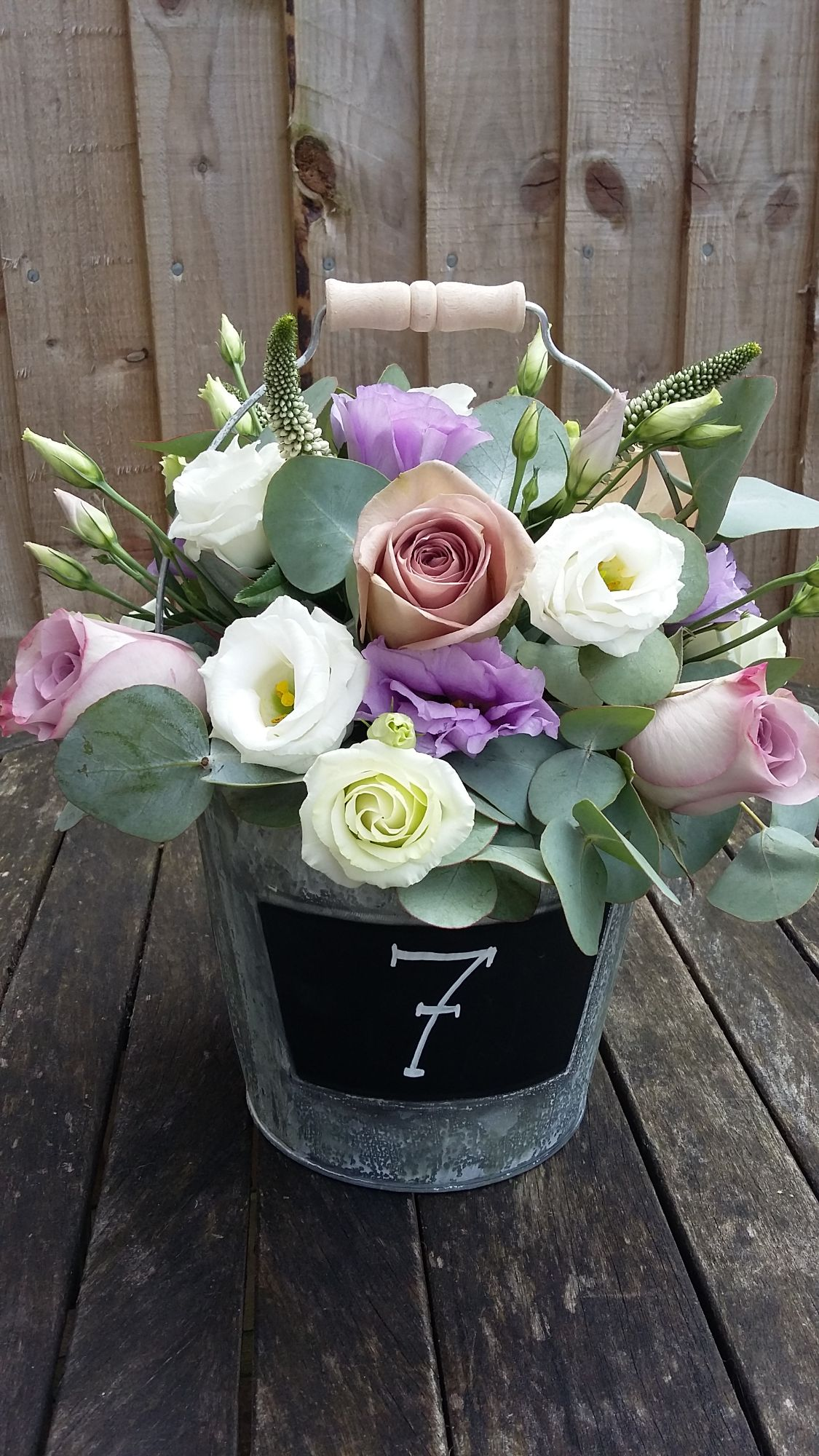 Flowers in bucket wedding