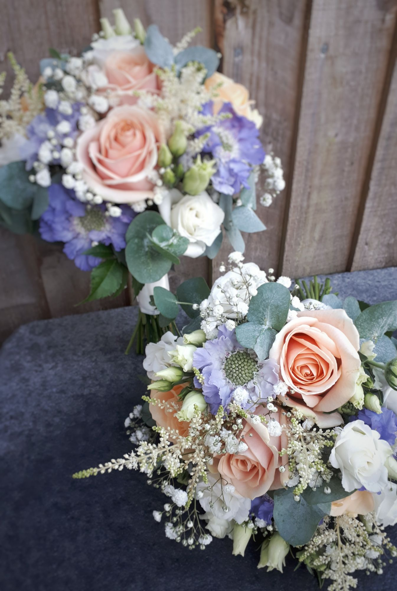 Pale blue and peach wedding bouquet