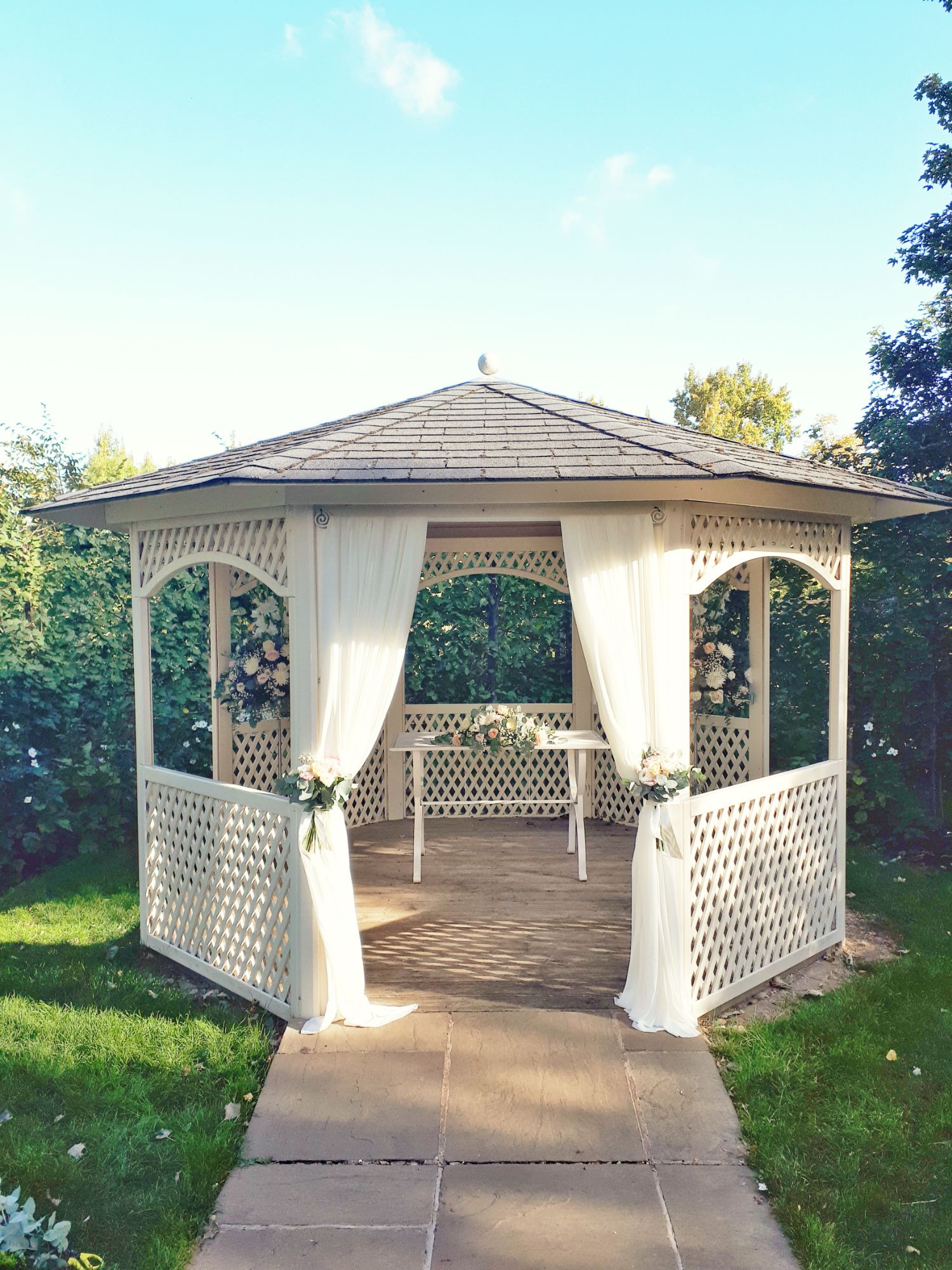 Outdoor wedding flowers and drapes
