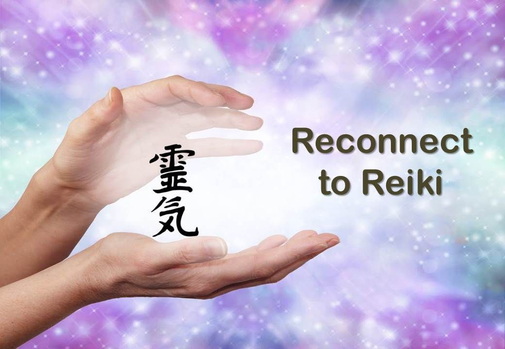 Hands holding Reiki Kanji