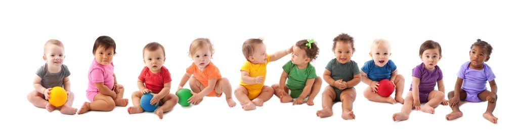 Diverse-group-of-ten-babies-playing-157429705_13946x3585