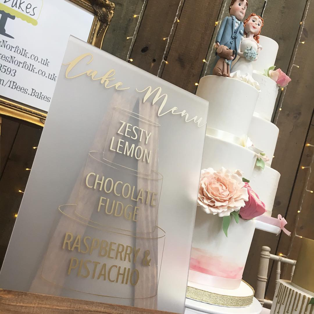 Frosted acrylic cake menu with gold vinyl lettering