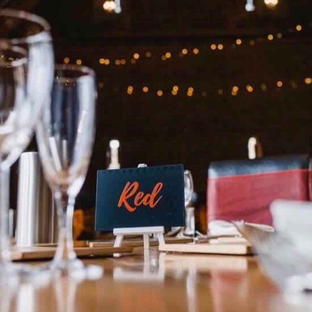 Chalkboard table name with red vinyl