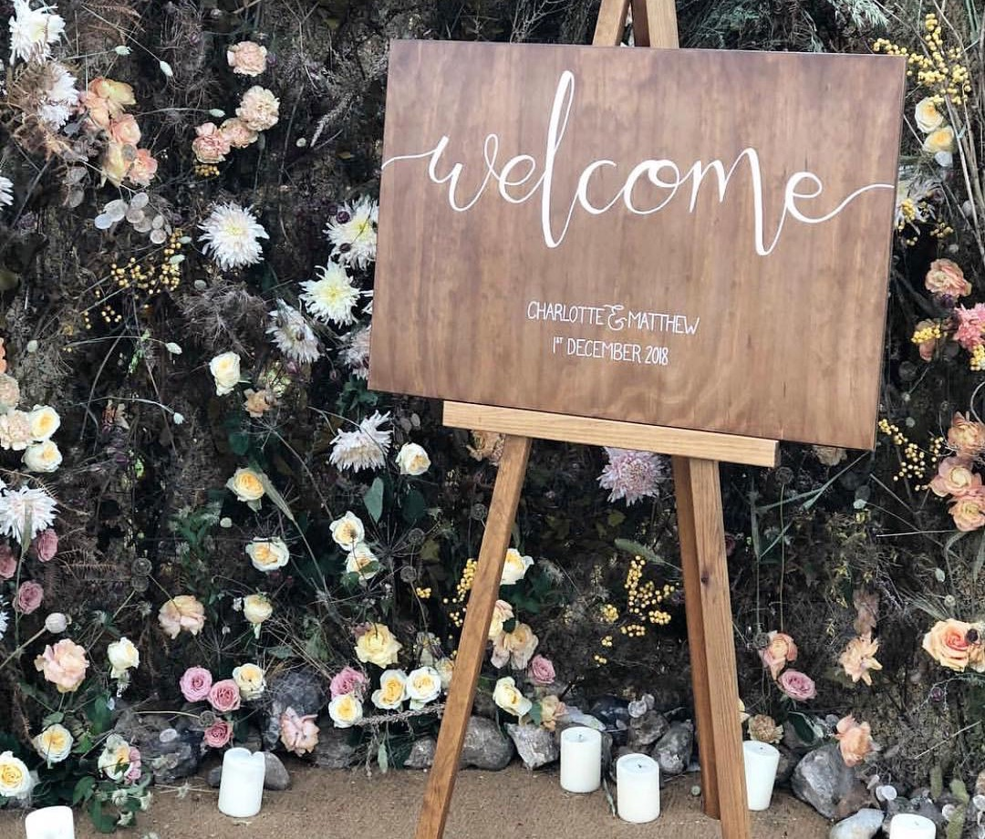 wooden welcome sign with modern calligraphy hand written detail