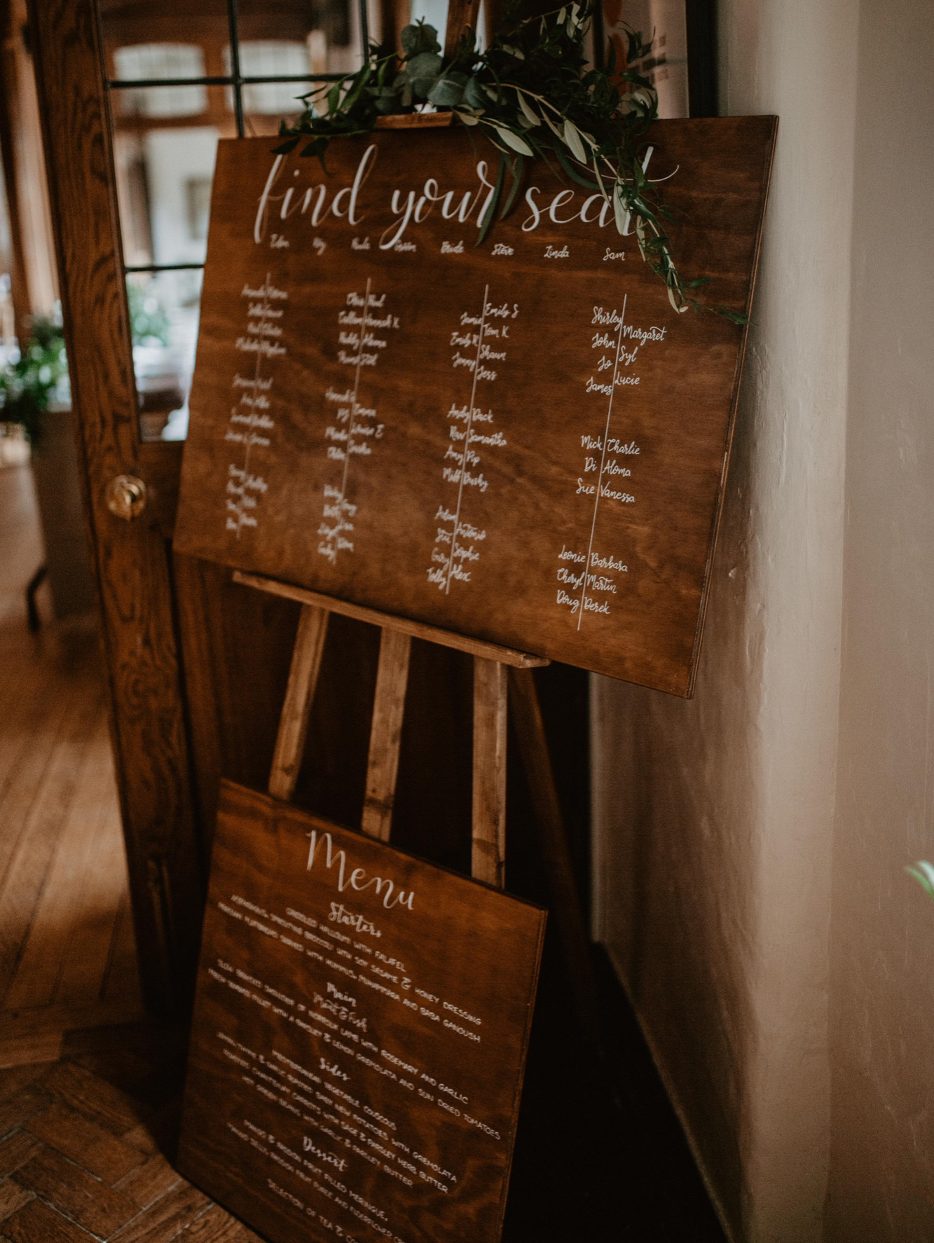 Wooden table plan and menu with modern calligraphy lettering
