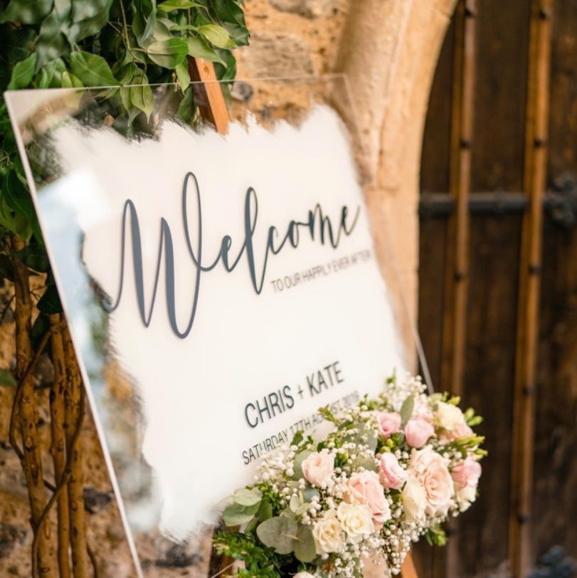 painted back perspex wedding welcome sign