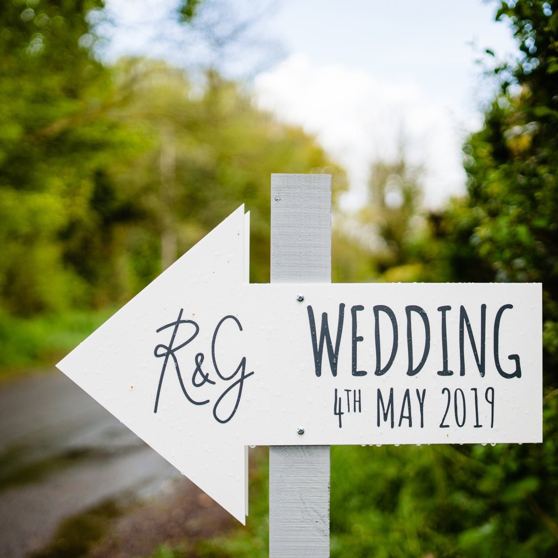 wedding direction sign post