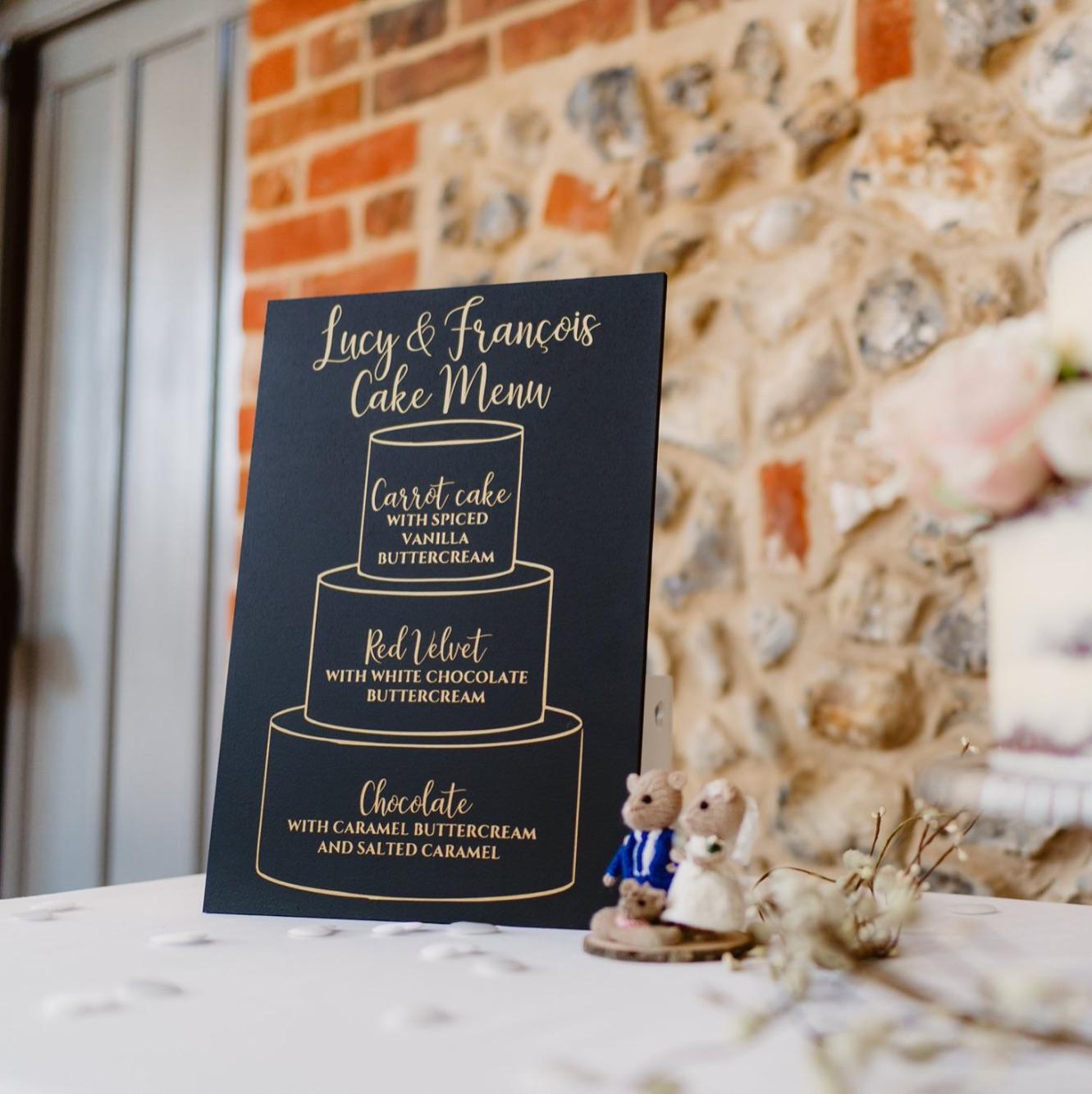 Cake menu on chalkboard with gold vinyl design