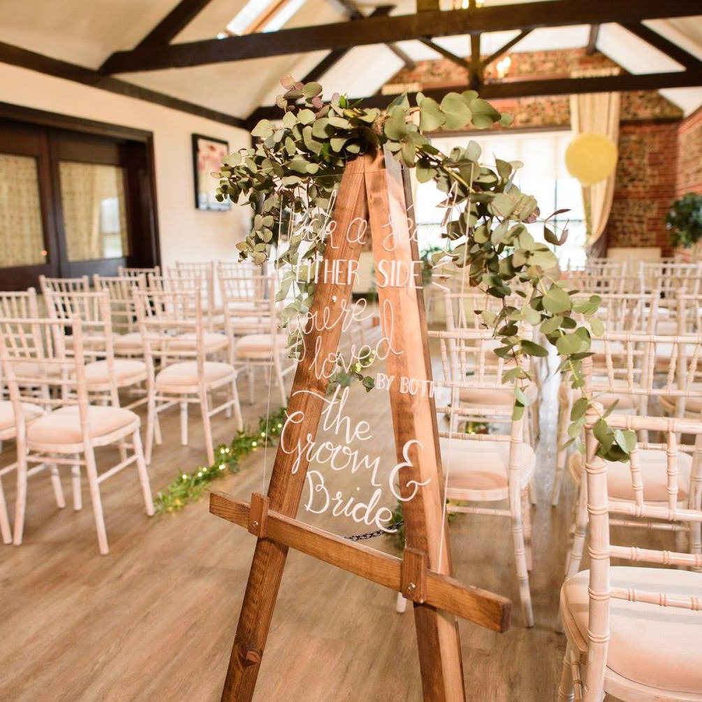 clear perspex ceremony sign 'pick a seat either side'