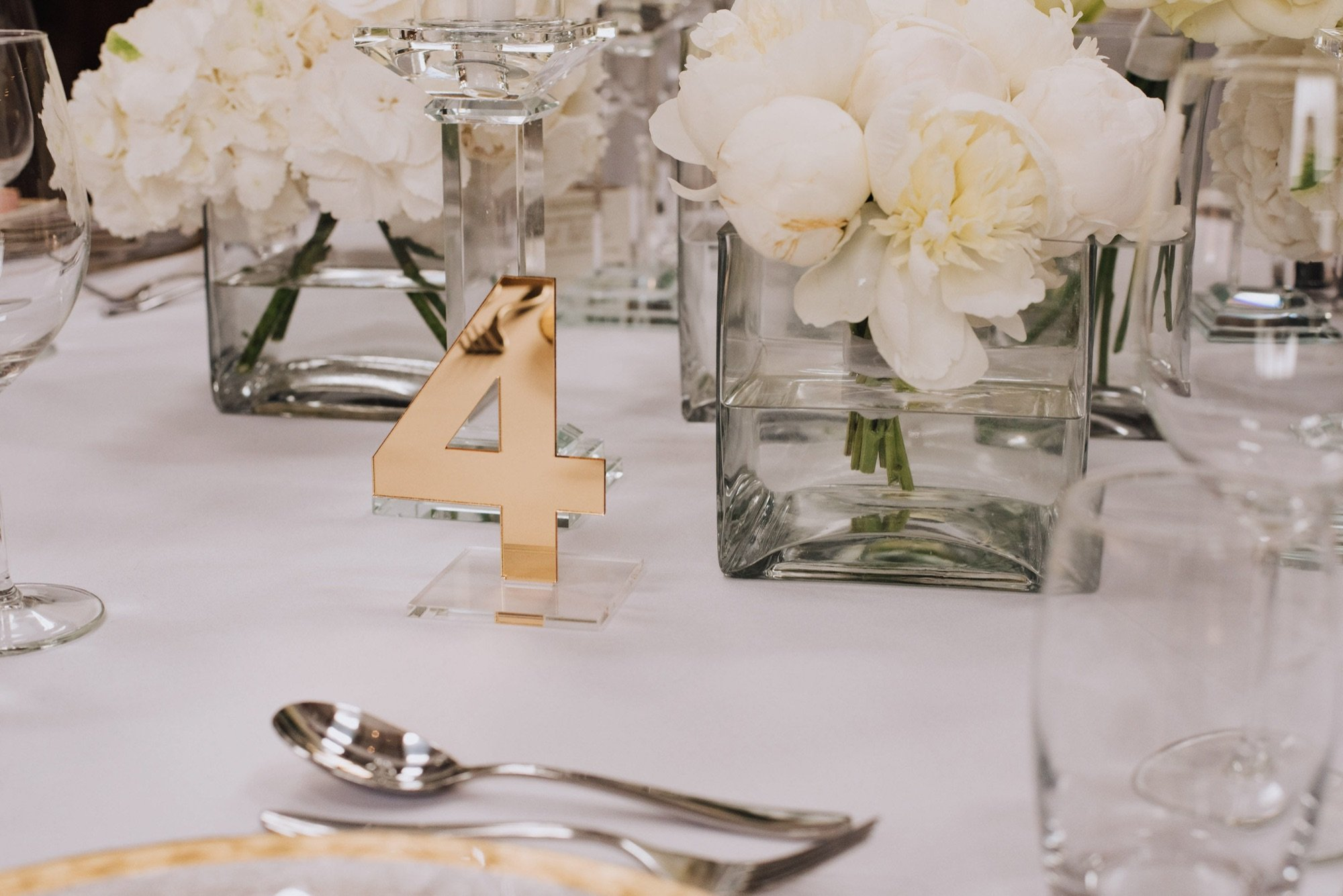 Clear acrylic table number with purpel vinyl lettering