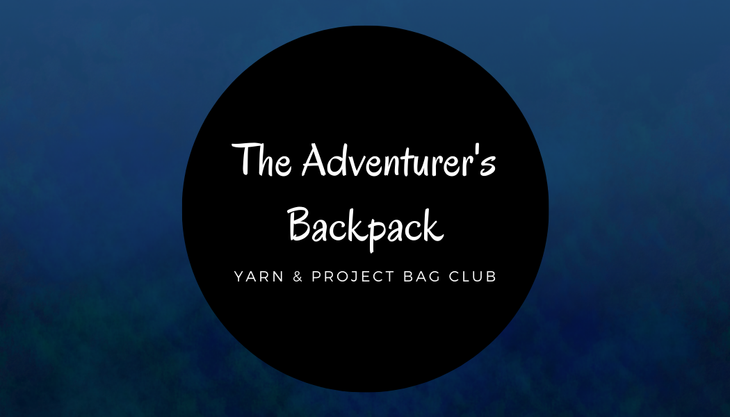 "a dark gradient blue background with green swirls, in the middle a black circle. White text written on the circle, in 2 different fonts. "" The Adventurer's Backpack"" and smaller ""Yarn & Project Bag club"""