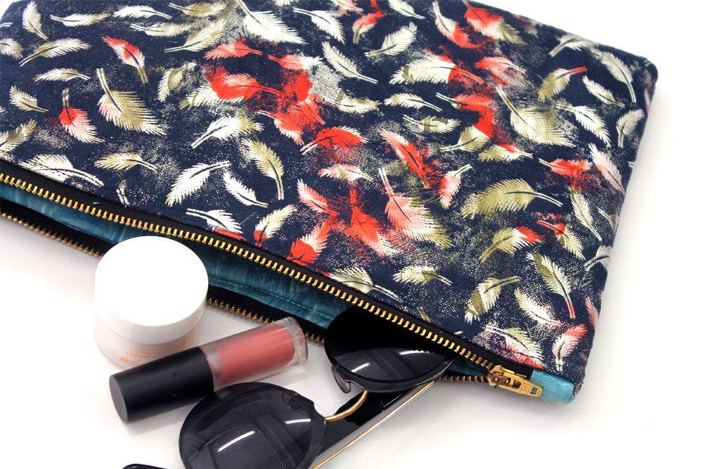 A Blue Feather Metallic Make up Bag
