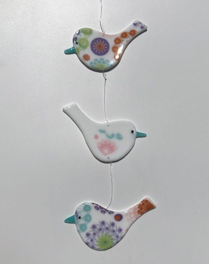 Trio of hanging White Opaque Birds with multi coloured mandala design