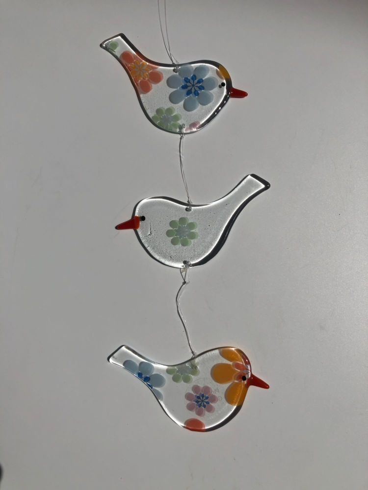 Trio of clear glass hanging Birds with multi floral design